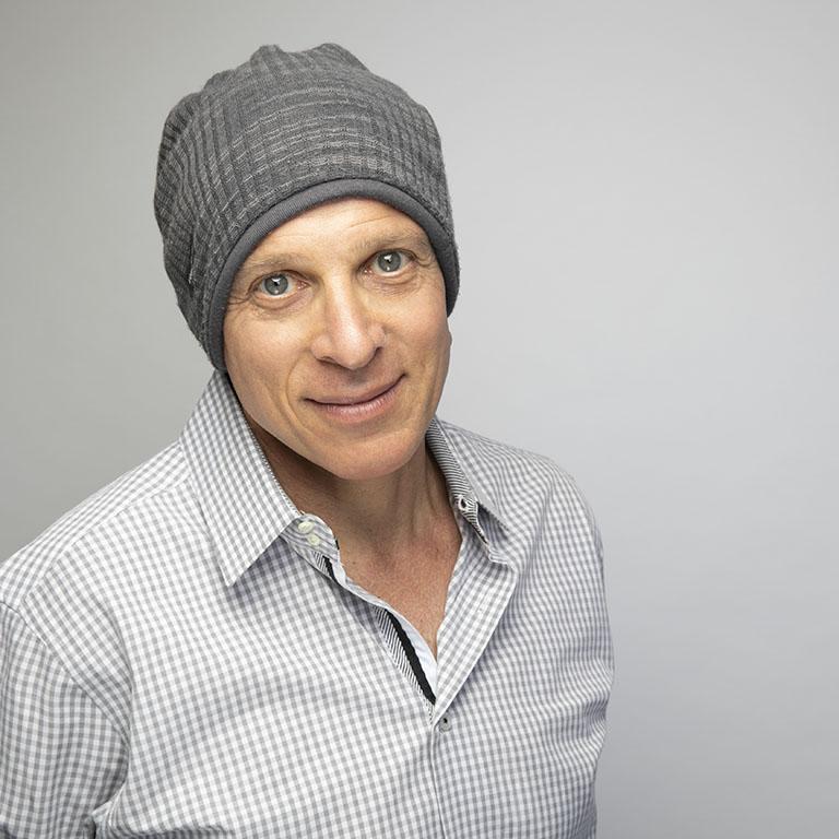 Steven Joseph, author, head shot with a hat